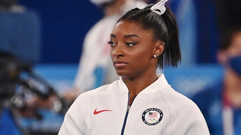 simone-biles-in-the-balance-beam-final-at-the-tokyo-olympics- -celebrities